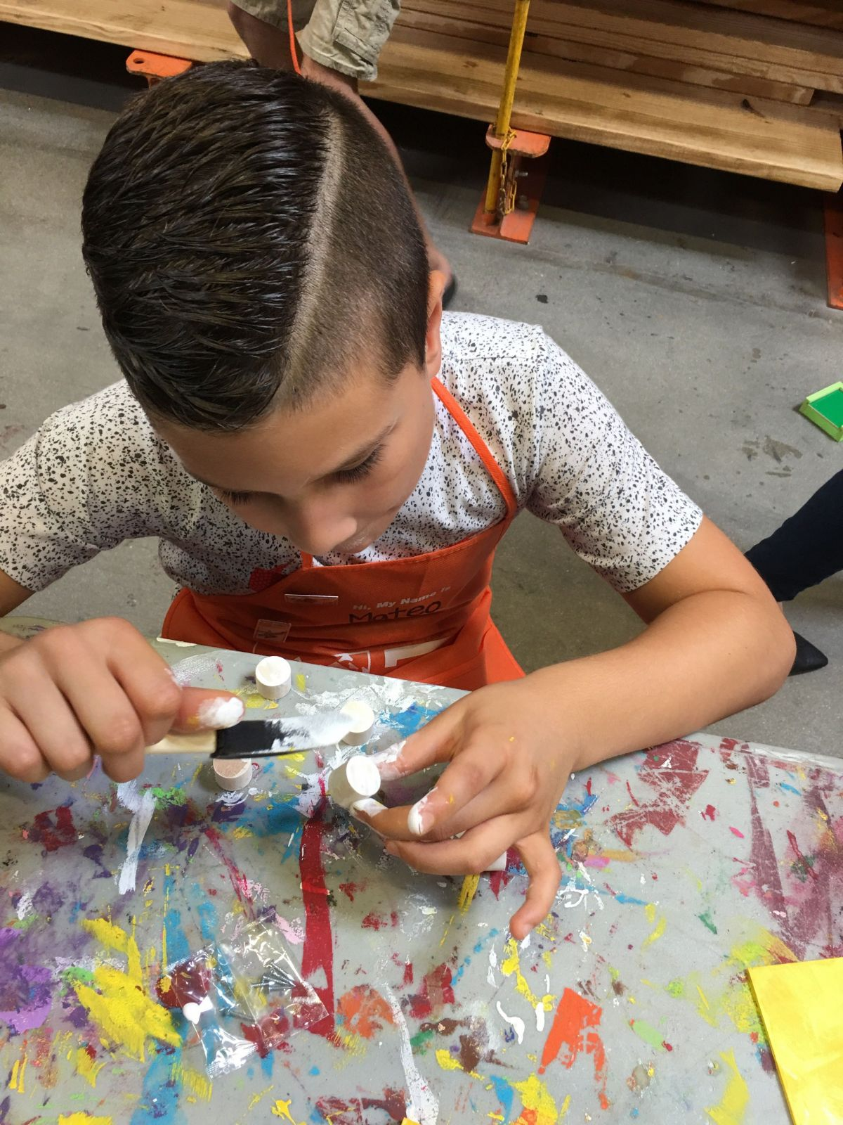 Photo of a young boy at school doing arts and crafts, focused