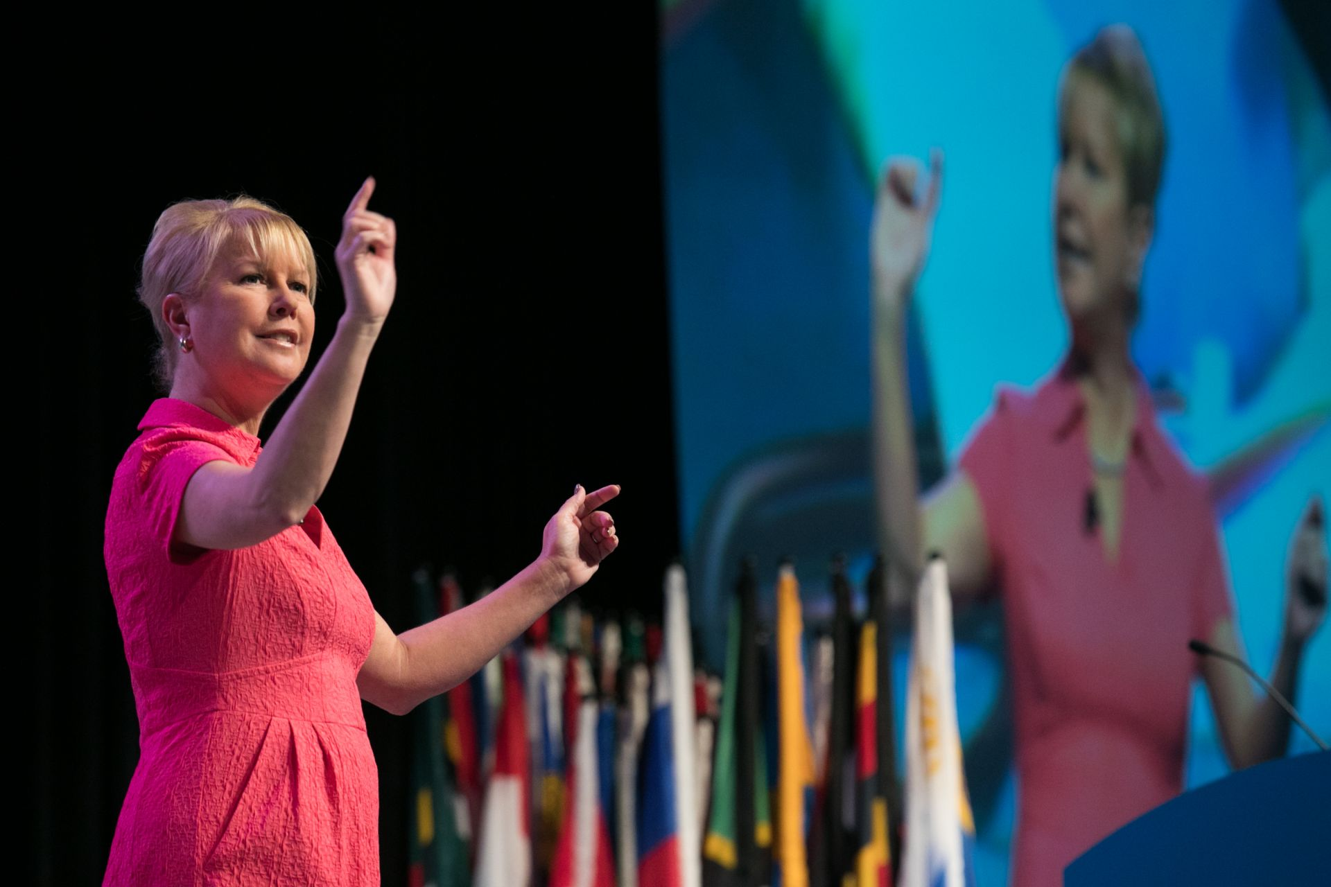 Jennifer Jones delivers a speech to an audience of Rotary members